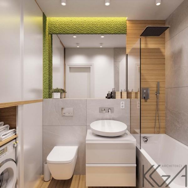 Mała łazienka w bloku z wanną i parawanem oraz mchem na ścianie!