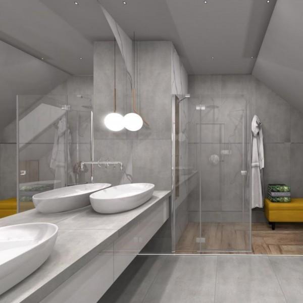 Elegancka łazienka na poddaszu z wanną wolnostojącą
