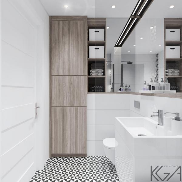 Biała łazienka w bloku z wzorzystymi płytkami na podłodze