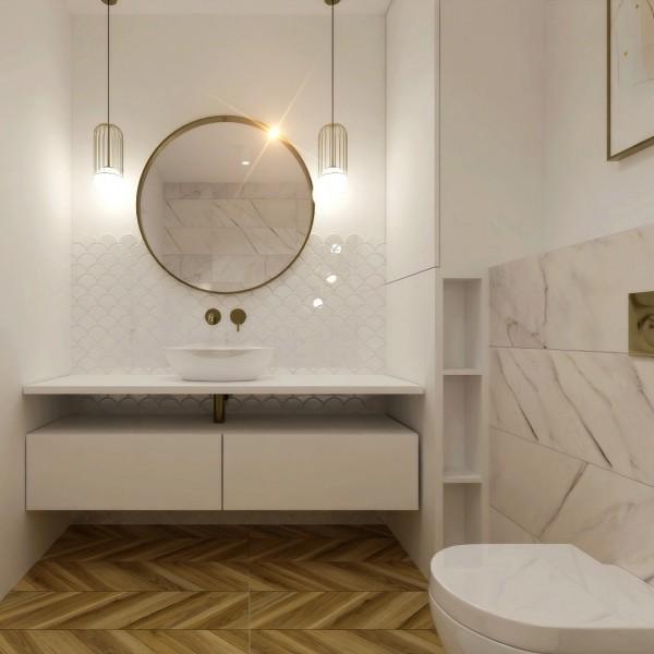 Mała złota łazienka w wanną wolnostojącą
